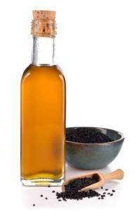 Bouteille d'huile de nigelle pour cheveux et peau